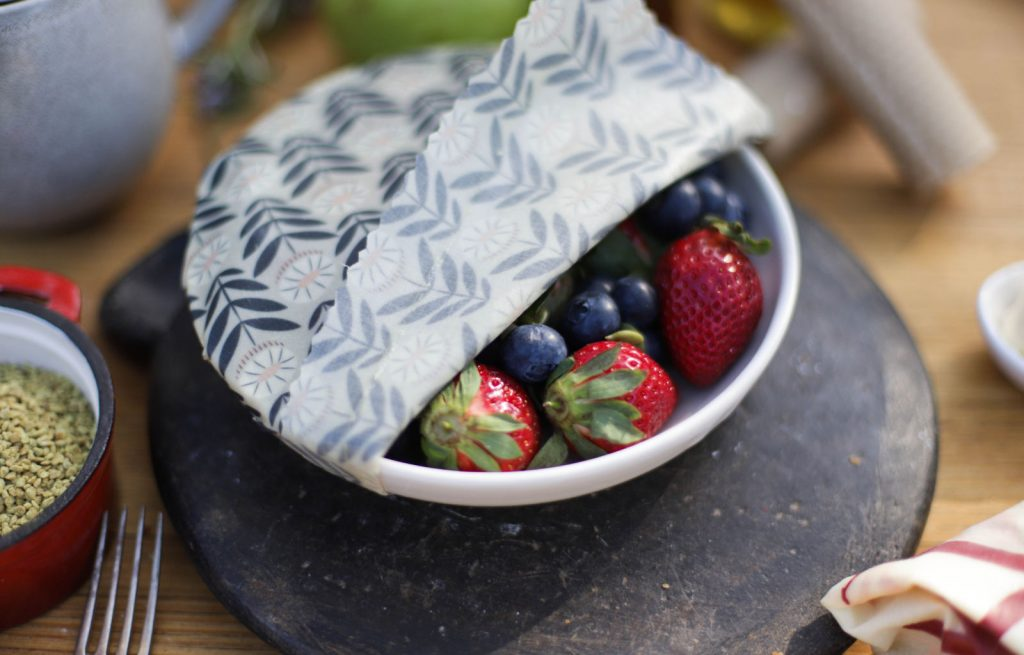 Sustainable beeswax wrap covering a bowl of food