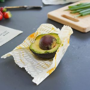 half an avocado in beeswax wrap