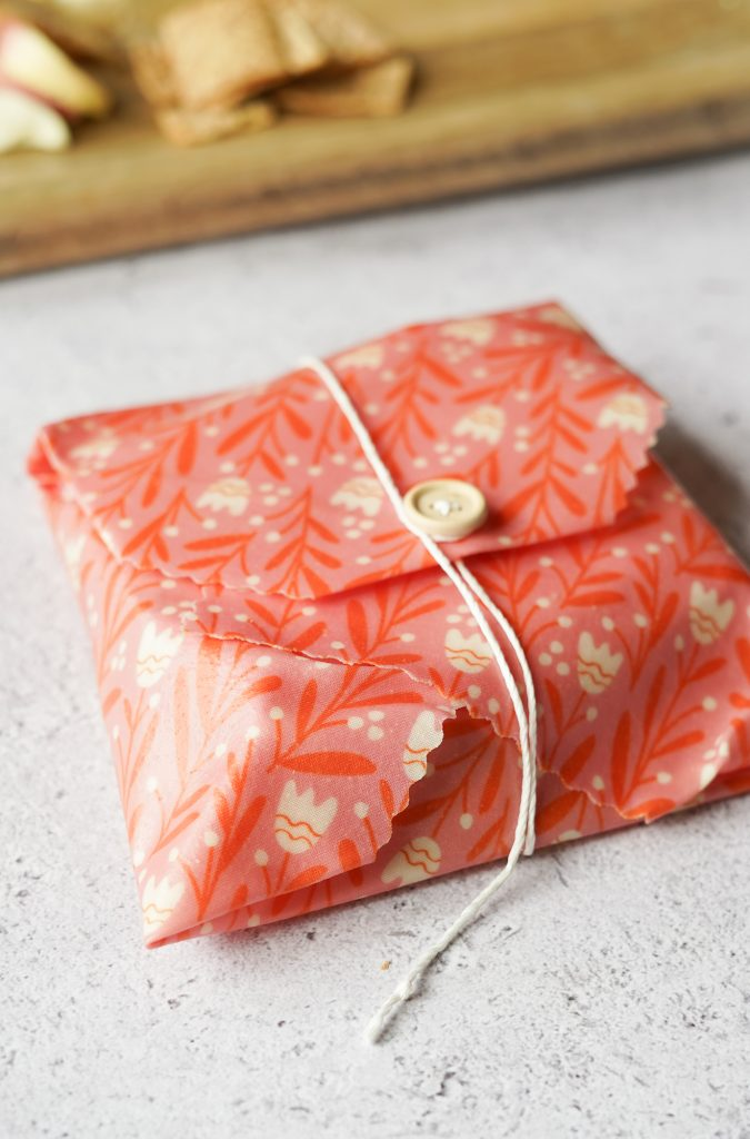 sandwich in beeswax wrap tied up